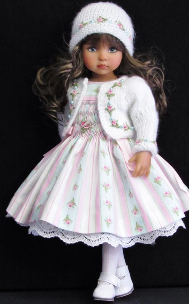 """Made for effner little darling13"""" dolls. Smocked dress,hand-knit sweater , This set includes:**Smockeddress features hand smocked design with embroidered flower,short puffed sleeves,snap closures and tie in the back."""