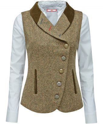 Bring a touch of the English countryside to your look with this tweed waistcoat. Assorted buttons and contrast buttonholes add a twist to the traditional feel. Layer it over a casual blouse to add heritage style to your outfit. Approx Length: 61cm Our model is: 57 Shirt sold separately