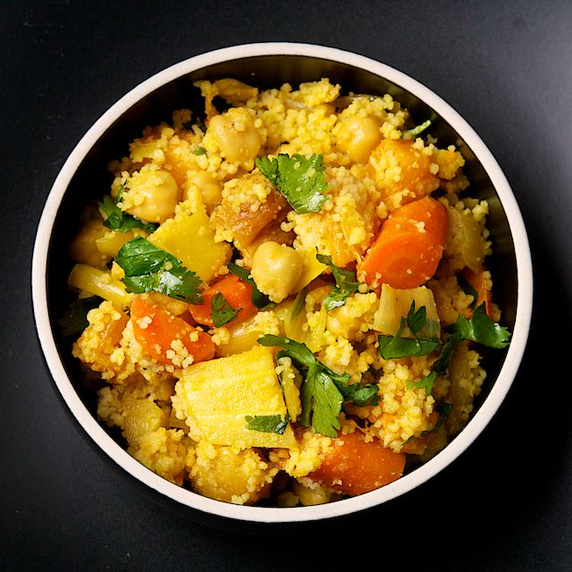 WINTER COUSCOUS from Yotam Ottolenghi, published in Plenty. The best part of this very good recipe comes from the fragrant baked cinnamon sticks, star anise and bay leaves.