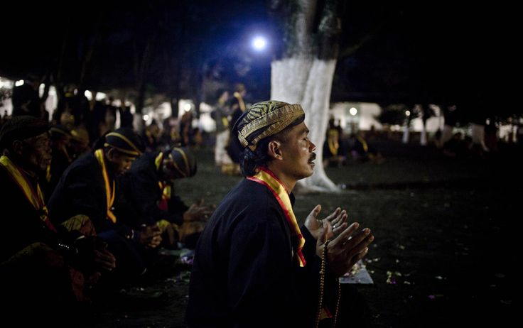 """Javanese people pray before rituals night carnival """"1st Suro"""" ( Javanese calender) during  Islamic New Year celebrations at Kasunanan Palace on November 14, 2012 in Solo City, Central Java, Indonesia. Javanese will celebrate the national holiday with ceremonies and rituals marking the 1434th Islamic New Year's Eve or """"1st Suro"""". The parade started from Keraton Kasunanan and is headed by a group of albino buffaloes, known as Kebo Bule. Local people believe that the parade of Heirlooms and…"""