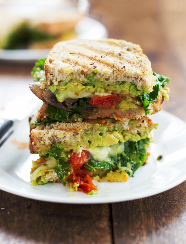 Avocado Veggie Panini with tomatoes, mushrooms, and spinach.
