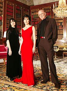 Here is the 'REAL' Enya, the triad consists of Eithne Ní Bhraonáin or Enya Brennan, who sings and plays most instruments on the CDs, Roma Ryan who writes the lyrics, and Nicky Ryan who deals with the music and the business. They all live together in a Castle outside of Dublin, enjoying a very reclusive lifestyle, much to the medias distaste.