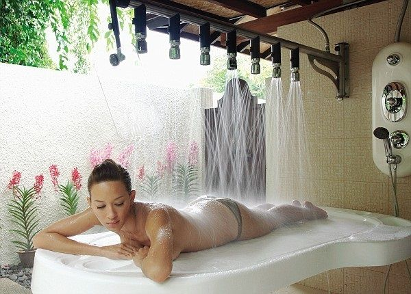 After reading about massages at the Sentosa Resort & Spa you'll feel almost as relaxed as this girl.