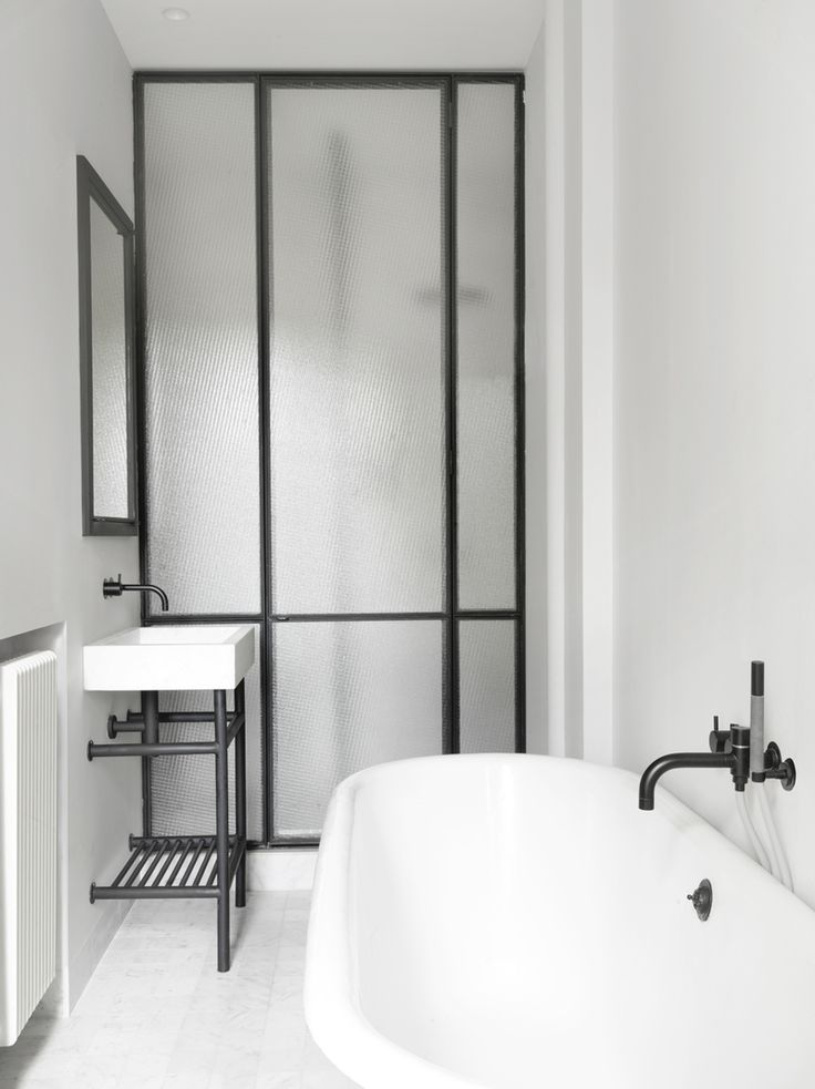 French Bathroom in Paris, France by Nicolas Schuybroek architects French minimalist chic