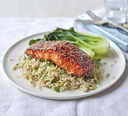 Sticky teriyaki salmon rice. A simple solo supper with Asian flavours. Serve marinated, grilled fish on a bed of brown basmati rice with coriander and lime