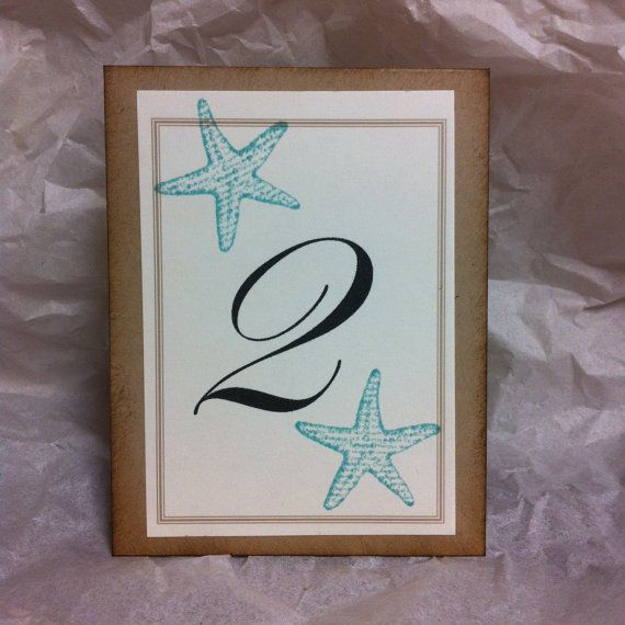 Beach Starfish wedding reception table numbers by stampingblock, $20.00