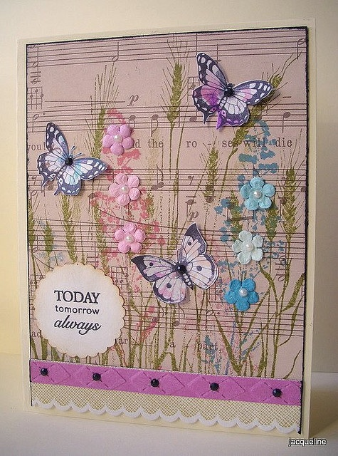 I love the music paper, and the way the flowers have been placed over printed flowers. The colours are great.
