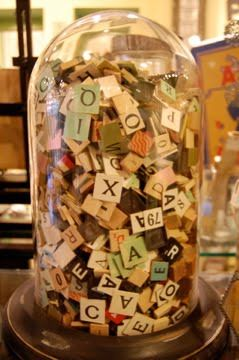 bell jar full of scrabble tiles and game pieces for when you have your dedicated board game room
