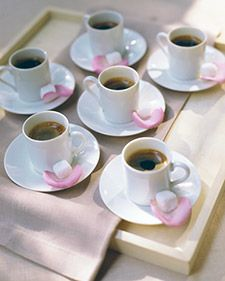 A dainty rose petal makes the perfect dish for a sugar cube awaiting a cup of coffee, tea, or espresso.