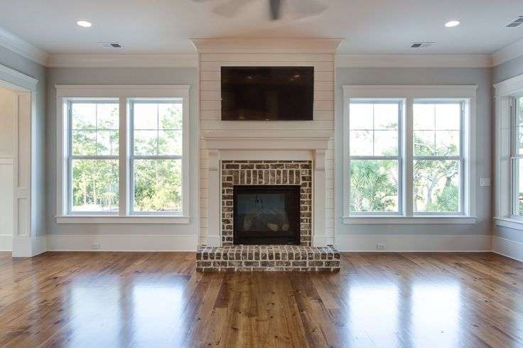 Like this brick design for fireplace. Rivertowne Home in Mount Pleasant, SC by JacksonBuilt Custom Homes