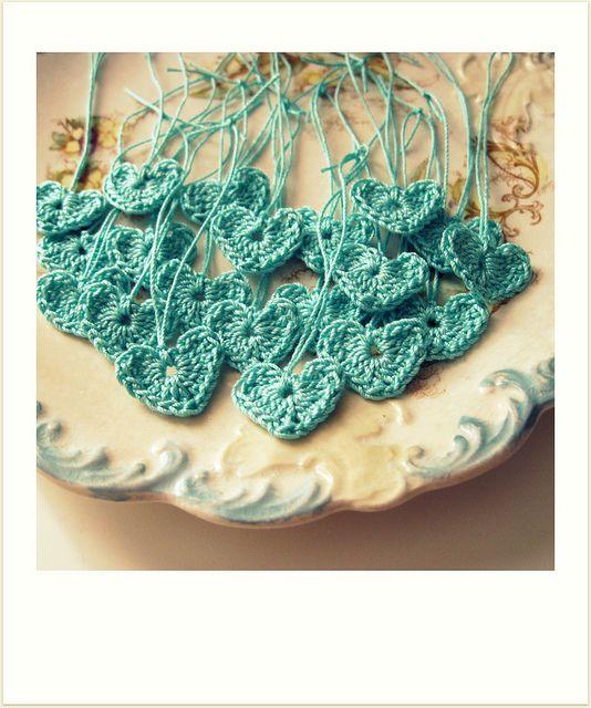 tiny blue hearts crocheted by cornflowerbluestudio (flickr) http://www.flickr.com/photos/cornflowerbluestudio/with/5464743441/ http://cornflowerbluestudio.blogspot.com/ #crochet #crafts #hearts