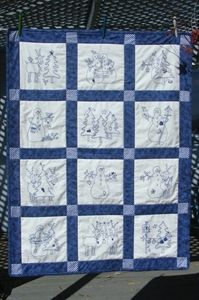 """A collection of Snowmen and their reindeer buddies stitched in """"chilly"""" BlueWork."""