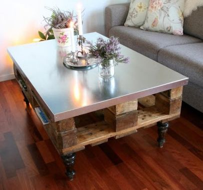 Top An Old Wooden Table With New Sheet Of Galvanized Steel