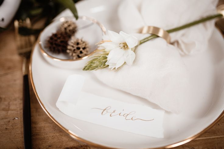 Gold calligraphy on cream place cards