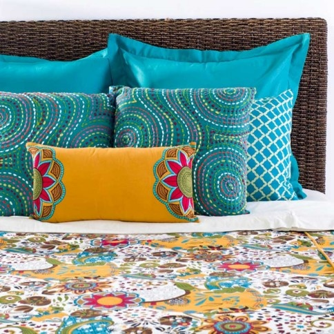 Love the colourful and patterned bedspread