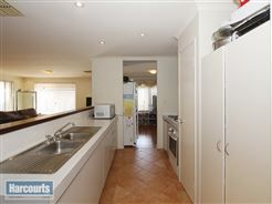 well appointed kitchen overlooking casual family area  To view more check out www.RegalGateway.com #realestate #harcourts