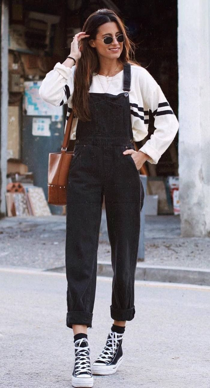 cce65e17f5 what to wear with a black denim jumpsuit   white sweater converse bag