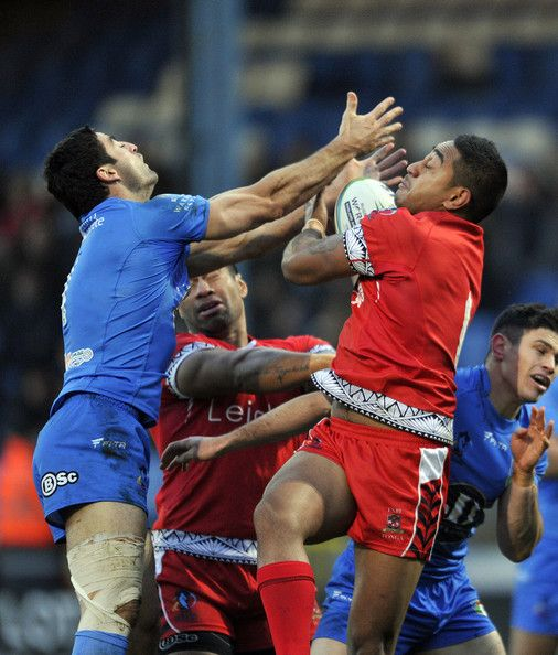 Nesiasi Mataitonga Photos Photos - Nesiasi Mataitonga (R) of Tonga and Anthony Minichiello of Italy battle for a high ball of Italy during the Rugby League World Cup Group C match at The Shay on November 10, 2013 in Halifax, England. - Tonga v Italy - Rugby League World Cup: Group C