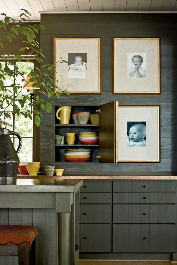 Sophisticated Camp Style: Woodsy Colors - Naturally Inspired Georgia Lake House - Southernliving. Framed family photos are backed with thin plywood and hinged to act as cabinet doors.    Source Guide Cabinetry paint: Porpoise (SW7047)