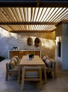 Not quite hard landscaping - slats over dining area to break up the sunlight.