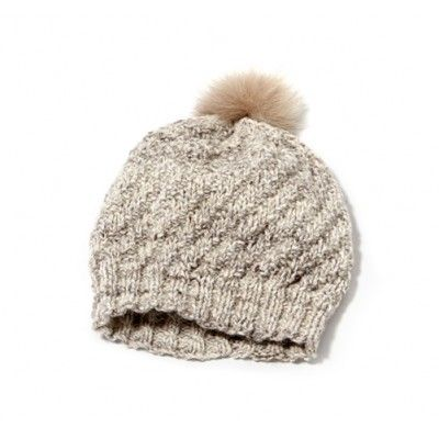 A cap with a fur pompom