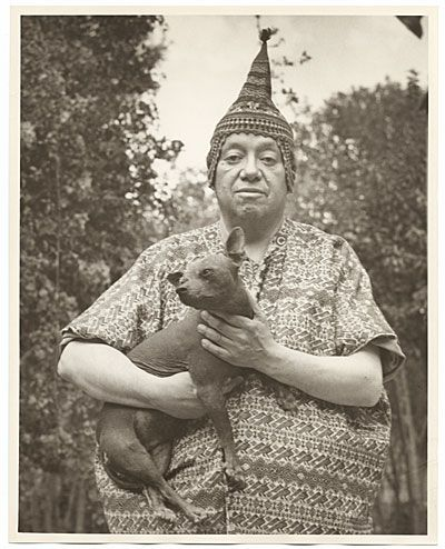Citation: Diego Rivera holding a dog, 194- / Guillermo Zamora, photographer. Florence Arquin papers, Archives of American Art, Smithsonian Institution.