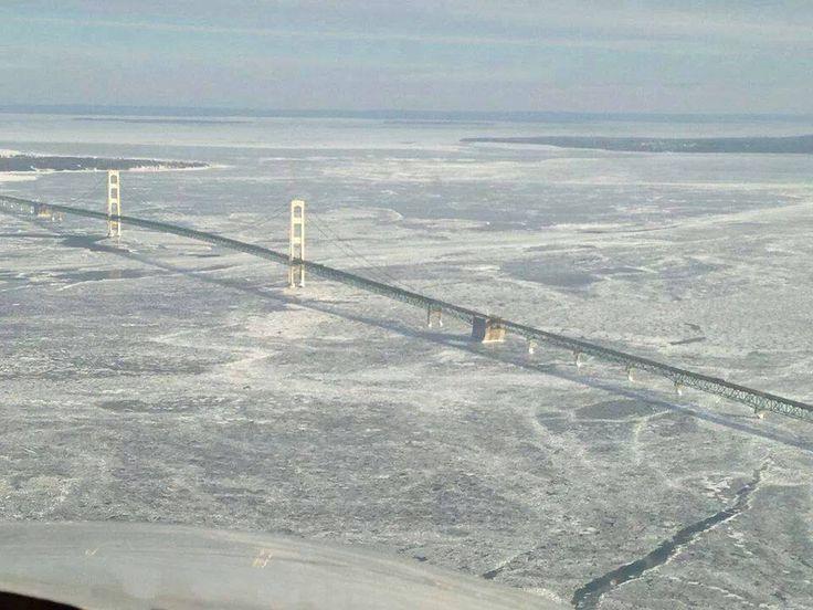 Frozen Straits of Mackinac, with the Mackinac Bridge, separating Lake Michigan and Lake Huron- January 2014
