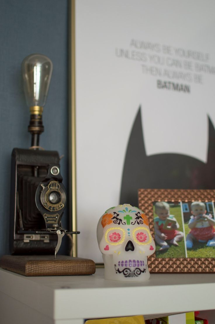 Lounge Tour - can't go wrong with a skull candle, batman artwork and upcycled camera lighting