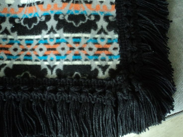 http://annmack.co.za/store/products/category/basotho-blankets/     Basotho blankets with a twist, each one has a fringe.