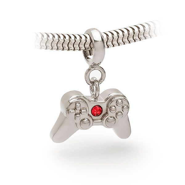 Travel back in time with this classic Game Controller Charm Bead. It's sure to bring back fond memories of long summer days spent with warm cartridges, fighting over whether there should be TV on the TV or a game (the correct answer is always game).