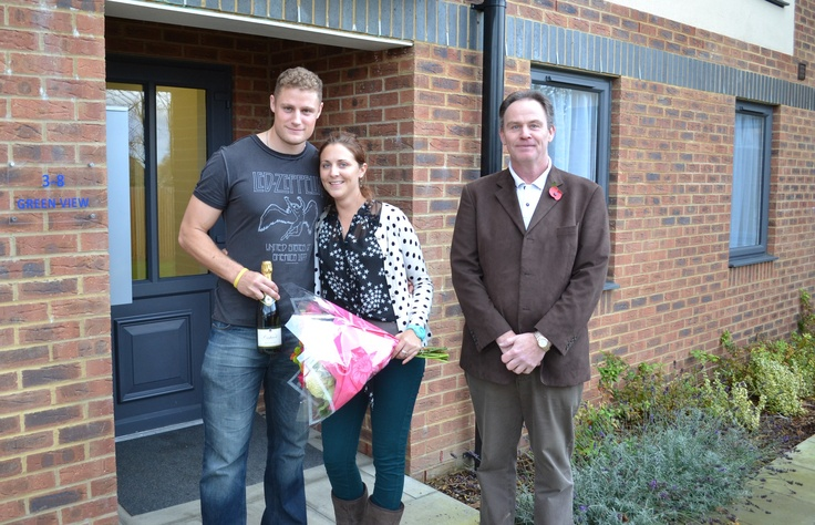 The final purchasers of Green View, Leverstock Green collect the keys to their new home from local developer Mr Rees of DB Rees Ltd