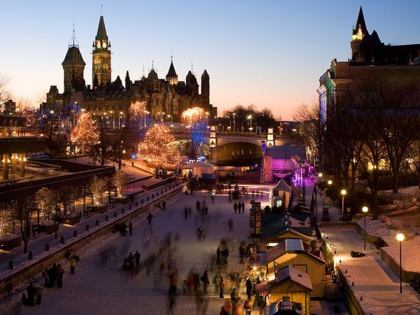 Ice skaters enjoy the world's longest skating rink—the frozen Rideau Canal, a 19th-century waterway that runs through downtown Ottawa.