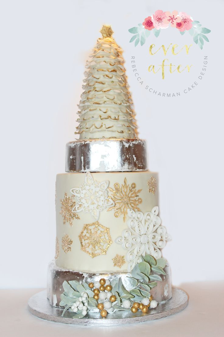 @everaftercake A cake made for a Christmas celebration. This is a vintage wonderland cake featuring lace snowflakes, hand quilled snowflakes, eucalyptus and winter berries. This design was inspired by Stevi Auble,