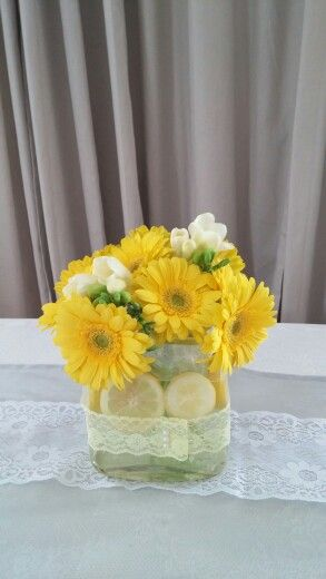 Yellow gerberas and white freesia centerpiece