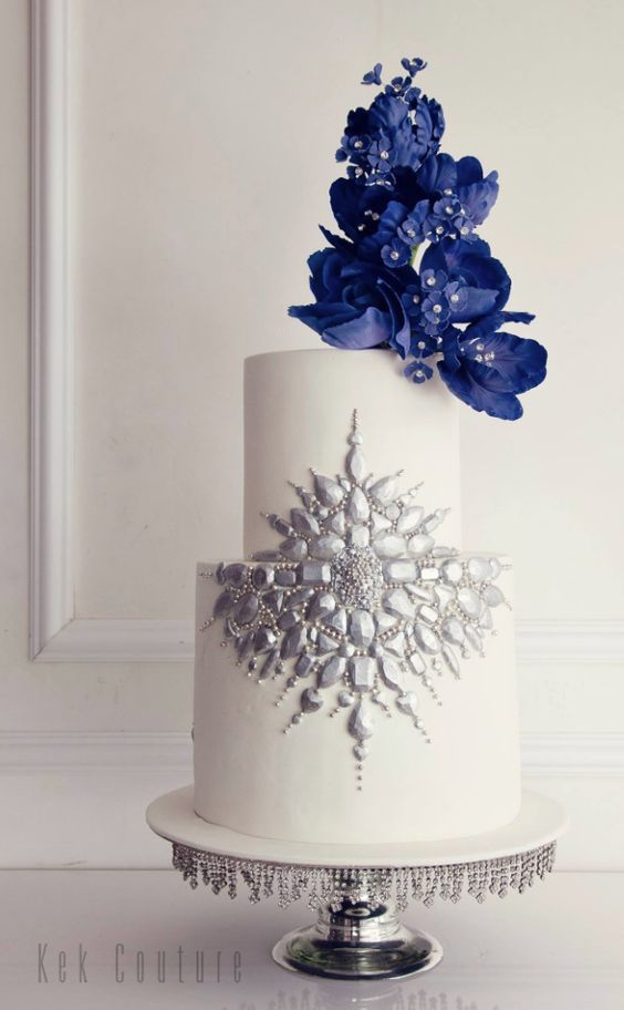 Featured Cake: Kek Couture; Elegant two tier blue flower topped wedding cake