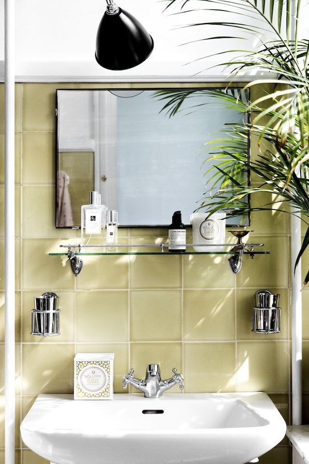 Green bathroom tiles in the fabulous Danish home of interior designer Natalia of Spatial Code / Line Thit Klein.