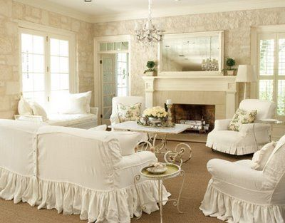 Love the shabby white ruffled couch covers