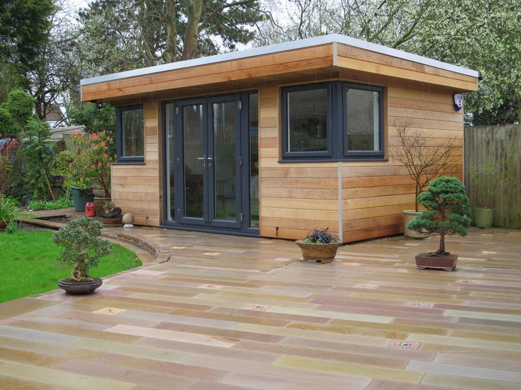 A beautifully clad garden room in Western Red Cedar built by Executive Garden Rooms.