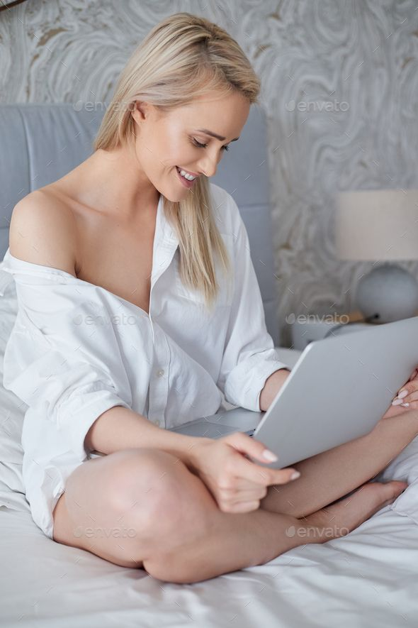 Beatutiful Woman In Mens Elegant White Shirt Sitting In Bed With
