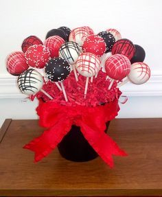 Cake pops colored and decorated in red, black, and white...
