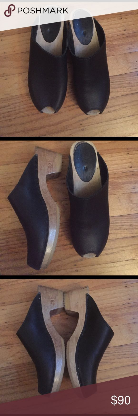 Peep toe sven clogs in black Comfy and loved clogs. Leather mid wool heel. Peep toe. Have been worn but has some life to them still. sven Shoes Mules & Clogs