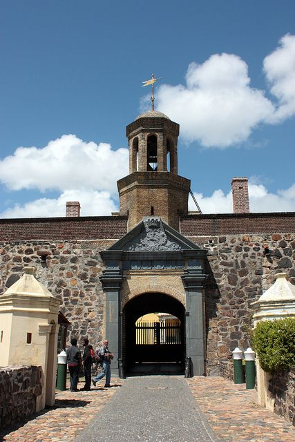 Entrance to the Castle of Good Hope, Cape Town, is the oldest surviving building in South Africa. Built between 1666 and 1679, this pentagonal fortification replaced a small clay and timber fort built by Commander Jan van Riebeeck in 1652 upon establishing a maritime replanishment station art the Cape of Good Hope for the Dutch East India Company.