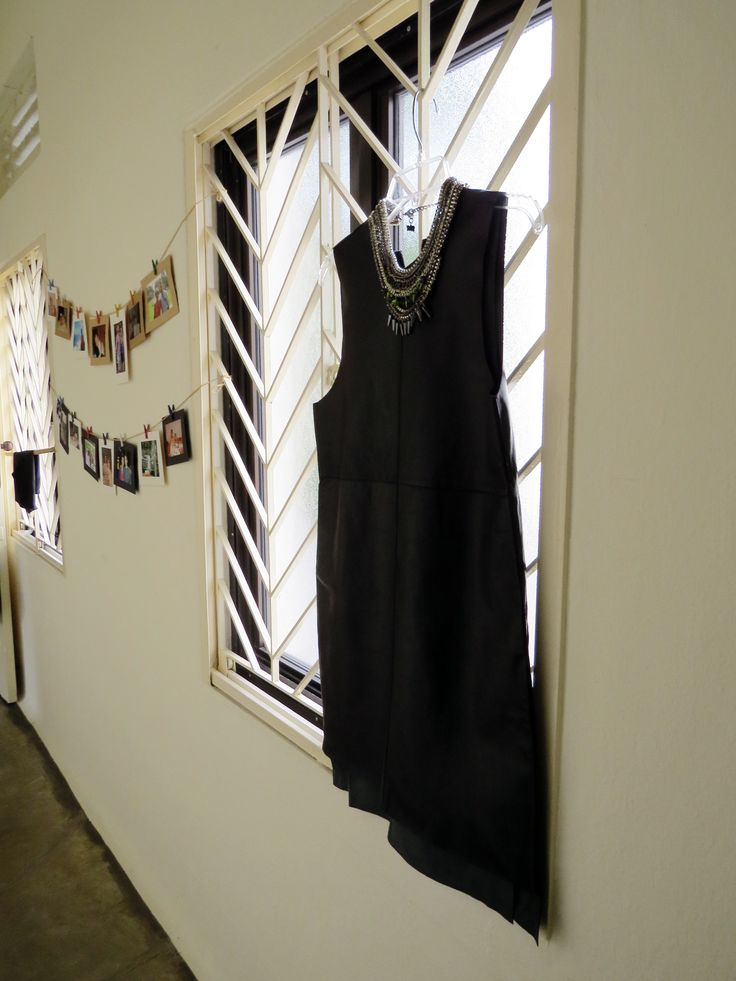 """Hello, Grace!"" on the ERIIN Blog. Jonas Leather Dress with the Queen Necklace, hanging on white window grilles."