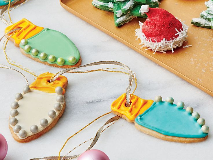 Christmas Bulb Sugar Cookies Recipe | These treats are as cute as can be, and their taste is just as memorable. Because they're made with sorghum syrup, ginger, vanilla, and cardamom, their flavor is a change of pace from the usual sugar cookies. Serve the light bulbs separately, or thread several of them on a decorative ribbon or string as a party favor or gift.