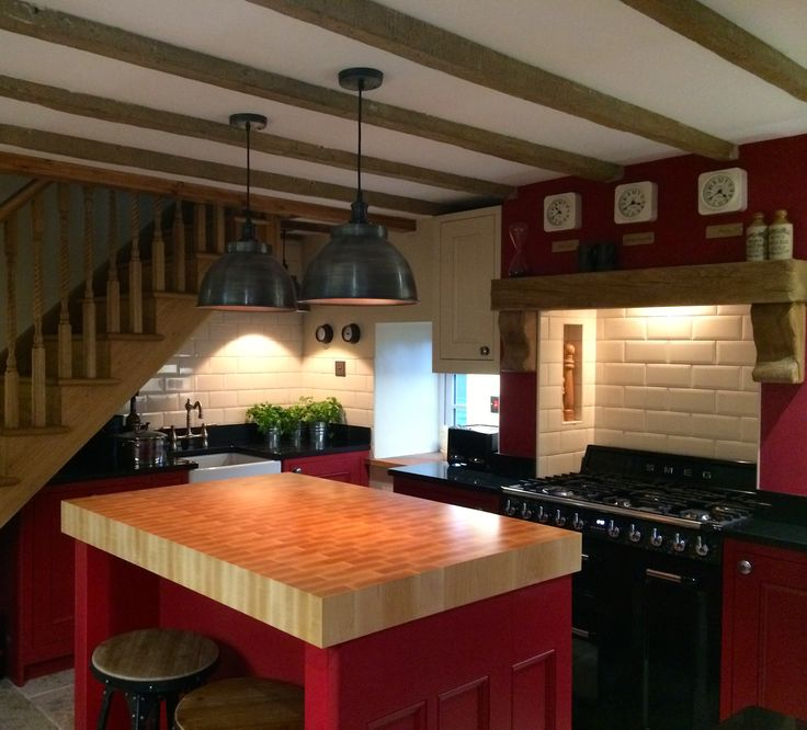 Shaker style kitchen in Farrow & Ball Rectory Red and Ringwold ground. Featuring recessed SMEG oven, custom made butchers block island and many other unique features. Designed by me Amelia Wilson Interiors!