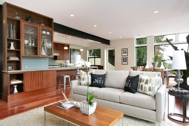 A look at the home's great room. Photo: Liz Rusby / SF.  love the reddish-tone floors with the beige furniture and walls, track lighting, dark accents