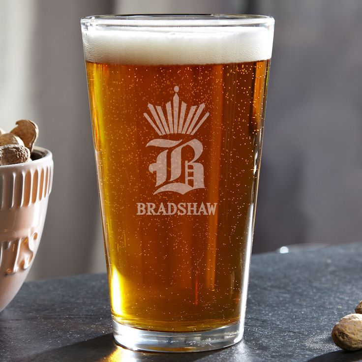 Throw a crown on your favorite beer with our King of Pints personalized beer glass. Custom made to feature your own royal initial as well as name, this noble beer glass is the perfect gift for any ...