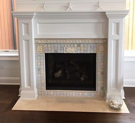 "Wood columns on each side ""sit"" on top of the granite hearth"