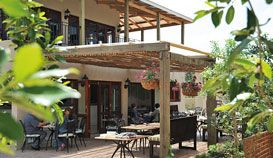 Casterbridge Hotel outdoor restaurant area to dine in nature