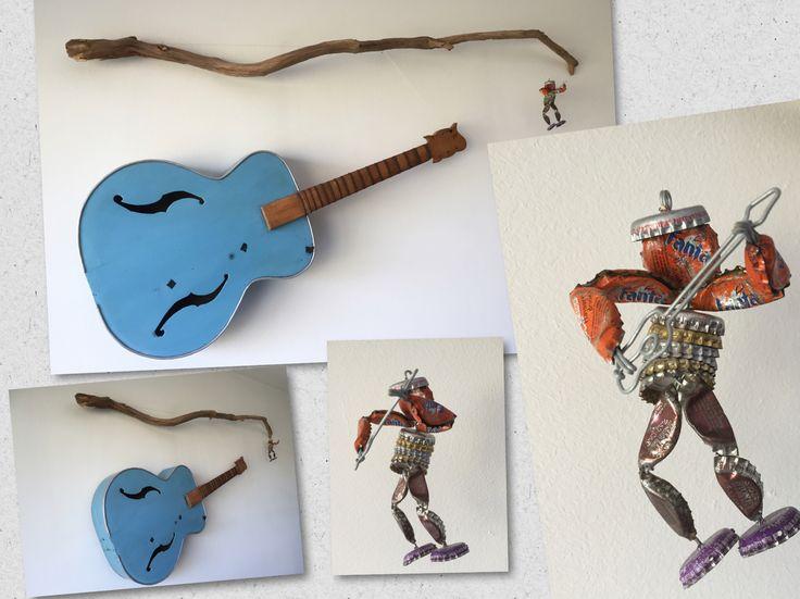 Wand decoratie gitaar en kroonkurkengitarist